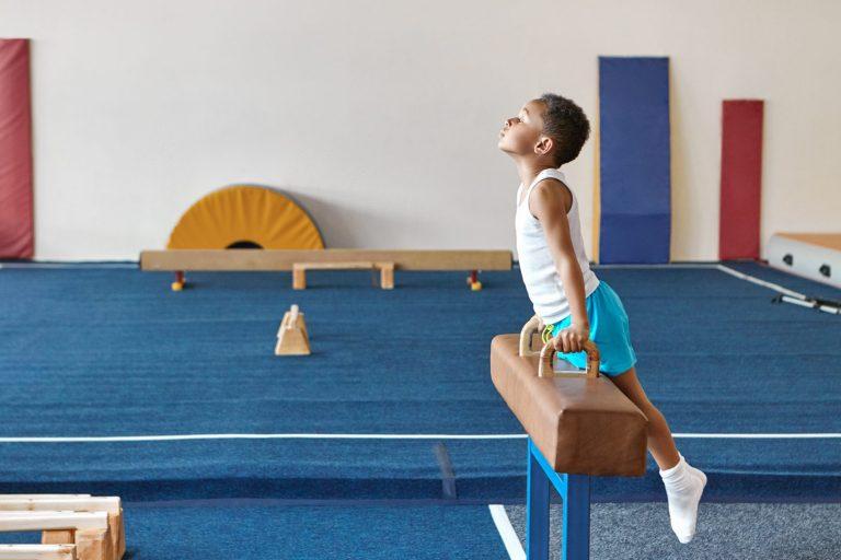 Boy practicing gymnastics
