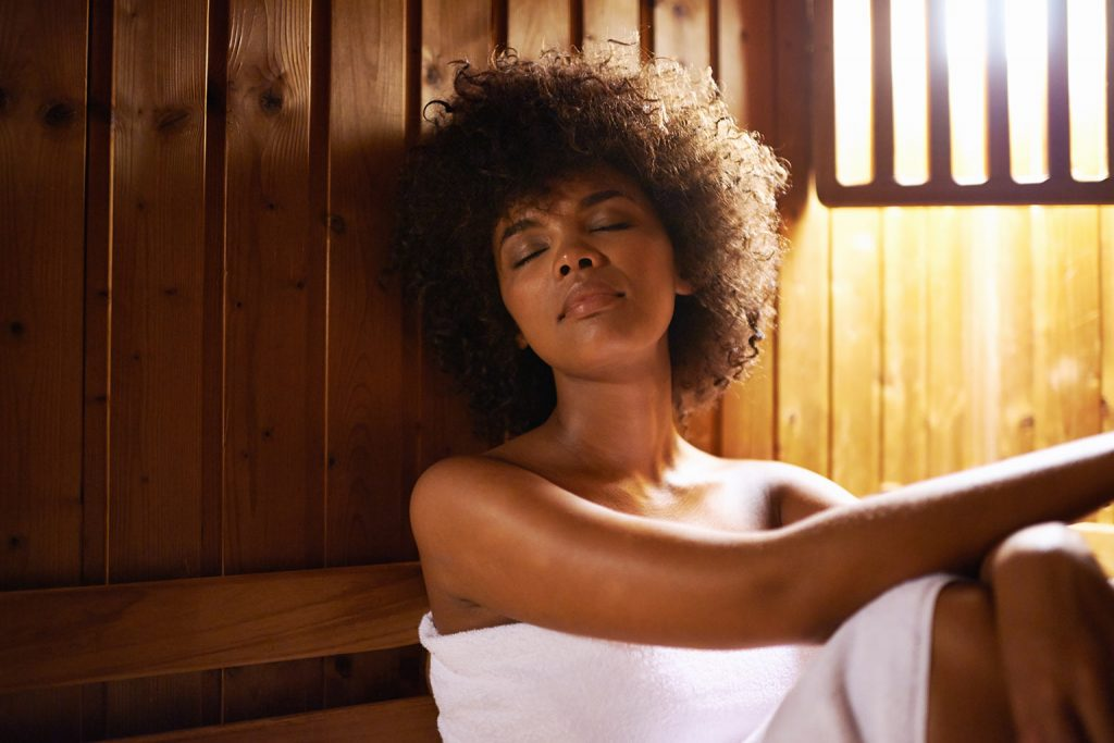 A woman relaxing in a sauna