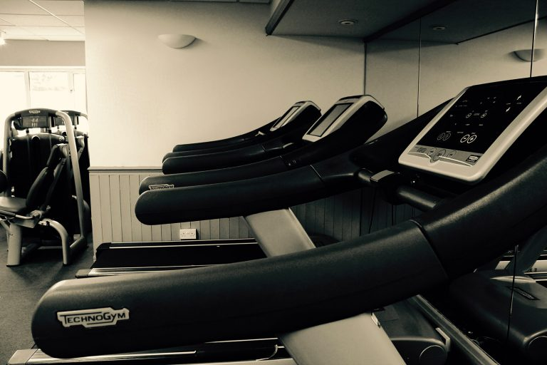 Treadmills pictured in a gym