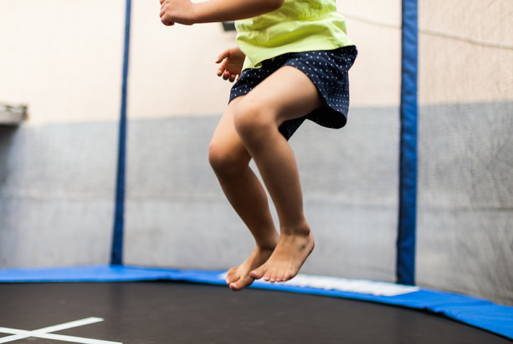 Photo of girl having fun on the trampoline